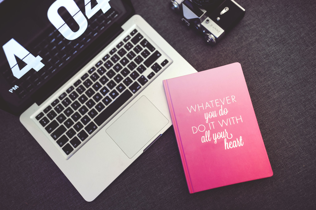 kaboompics.com_Pink Notebook with sentence and Apple Macbook