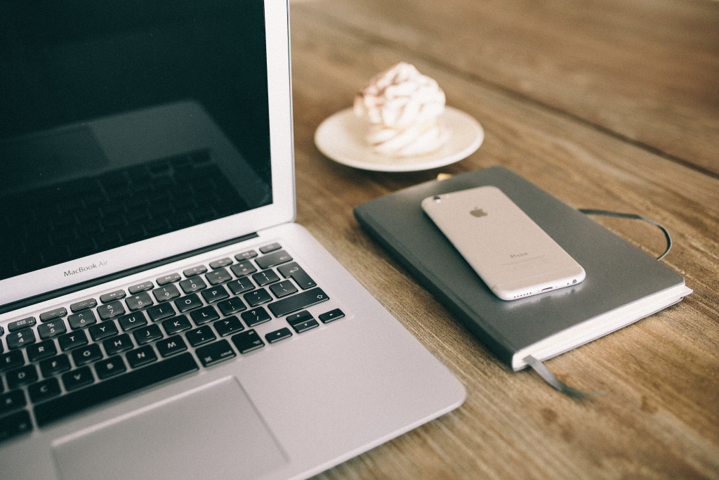 kaboompics.com_Workspace- Apple Macbook, iPhone and notebook on the desk